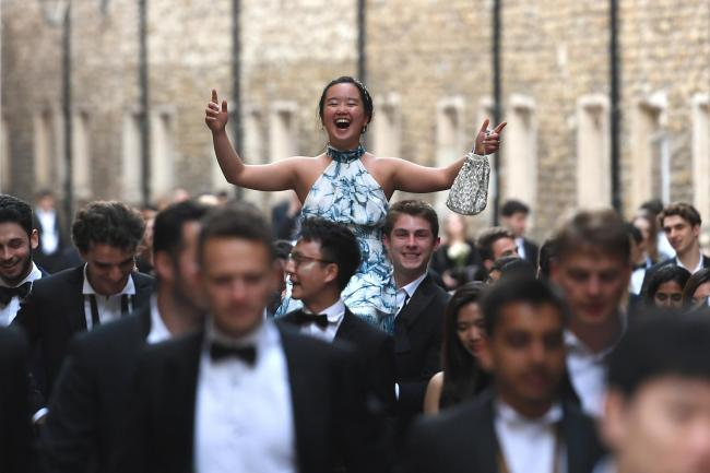 Cambridge University students make their way home after the May Ball
