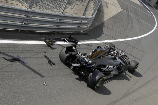 Romain Grosjean lost his front wing when he spun into the pit lane wall Picture: AP Photo/Luca Bruno