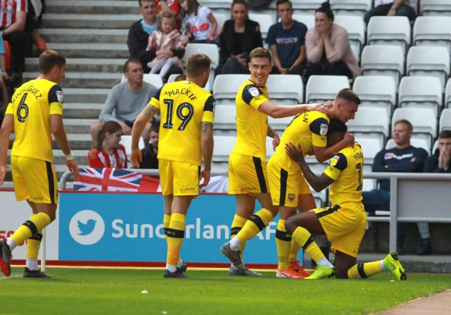 Tariqe Fosu is mobbed by his Oxford United teammates after opening the scoring against Sunderland Picture: Richard Parkes