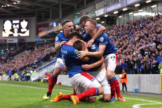 Linfield players celebrate Mark Stafford's goal