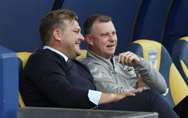 Coventry City manager Mark Robins (right) chats with Karl Robinson before the game  Picture: David Fleming