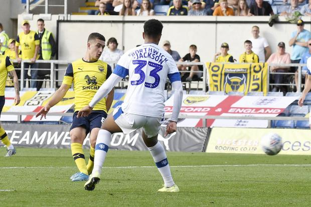 Cameron Brannagan slots in Oxford United's second goal against Tranmere Rovers  Picture: David Fleming