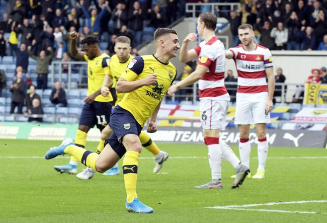 Cameron Brannagan celebrates putting Oxford United 2-0 up against Doncaster Rovers   Picture: David Fleming