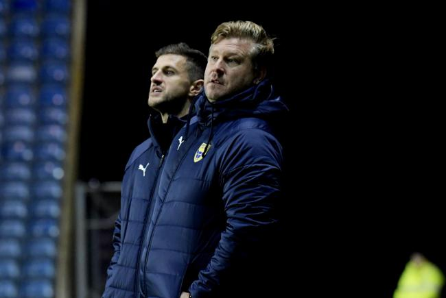 Oxford United head coach Karl Robinson (right) was joined on the touchline last week by John Mousinho 	Picture: David Fleming