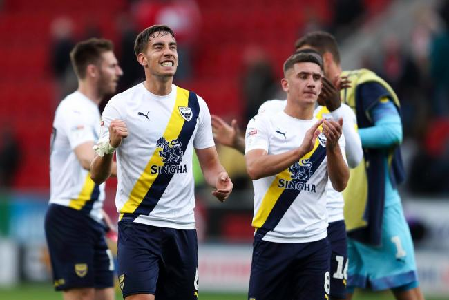 Alex Gorrin (left) and Cameron Brannagan celebrate Oxford United's draining victory over Rotherham United on Saturday 	Picture: James Williamson