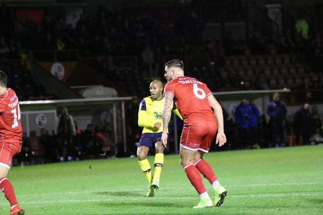Rob Hall scores the first of his three goals for Oxford United at Crawley Town  Picture: Steve Daniels