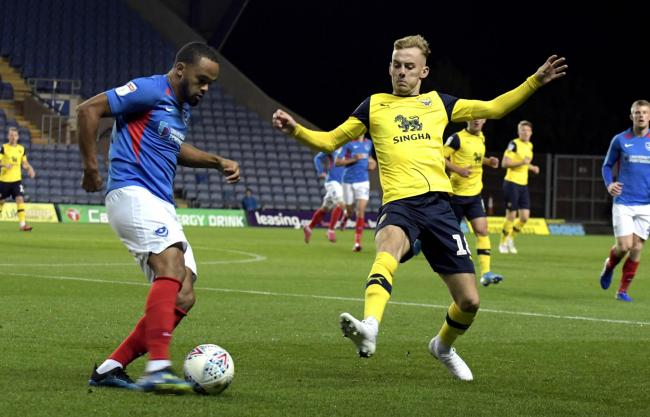 Mark Sykes puts a challenge in during Oxford United's Leasing.com Trophy group game with Portsmouth last month