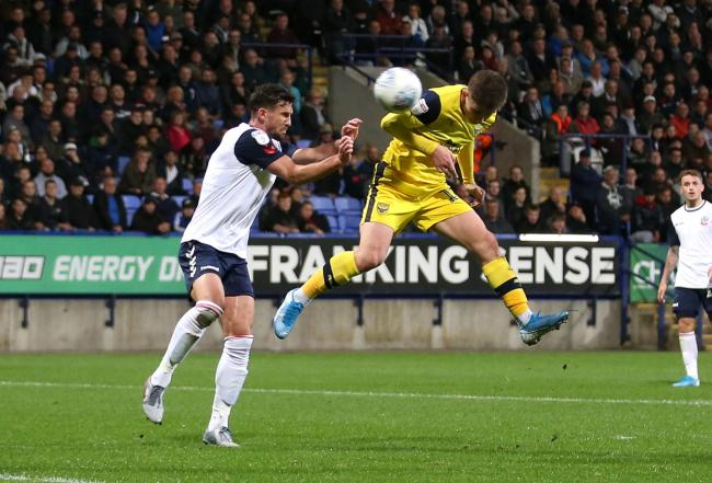 Ben Woodburn heads goalwards in Oxford United's meeting with Bolton Wanderers in September, which finished goalless  Picture: Richard Parkes