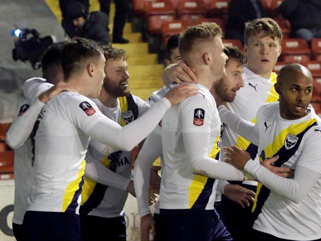 Oxford United celebrate James Henry's winner against Walsall in the Emirates FA Cup  Picture: David Fleming