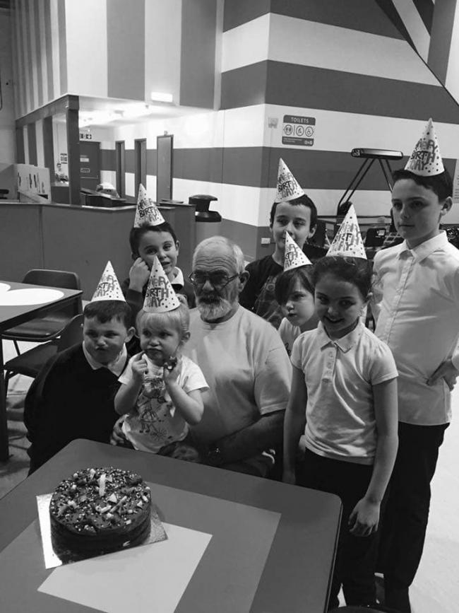 Grandad and grandchildren pulling faces for the family photo at a birthday party. Picture: Danielle Shepherd