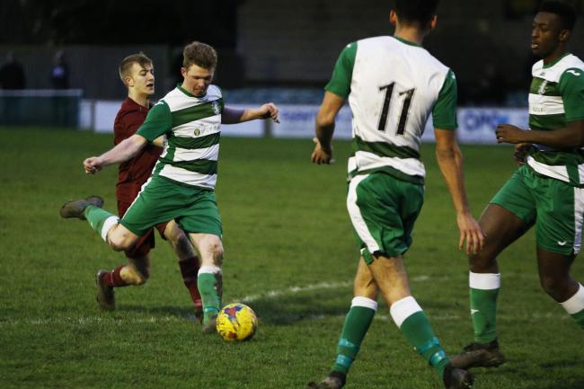 Wantage Town in action before the lockdown, when they were 13 points adrift at the bottom of the table		       Picture: Ed Nix