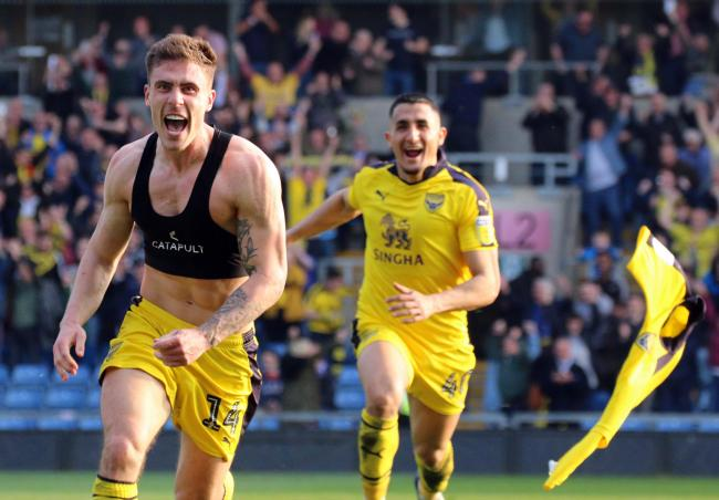 Josh Ruffels heads straight for Steve Daniels' lens after scoring a dramatic late winner for Oxford United last season   Pictures: Steve Daniels