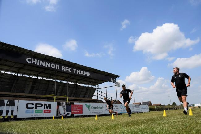 Sam Angell (right) and Caolan Ryan (left) are put through their paces by team manager Matty Mountford during Chinnor's first training session back after lockdown Picture: David Howlett