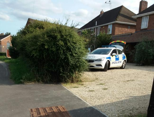 Police cars at the house in Faringdon after death of 38-year-old woman