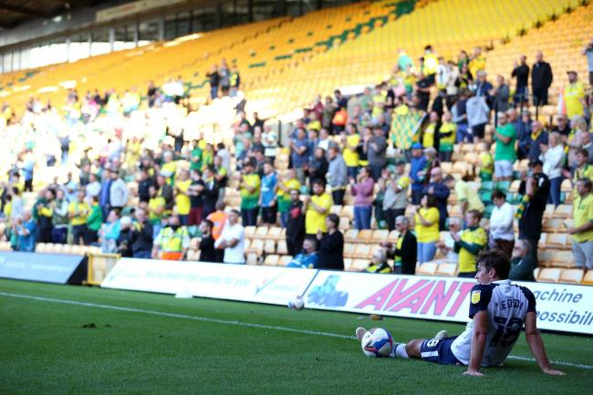 Ryan Ledson sits on the pitch at Carrow Road, one of the grounds to host a pilot event last weekend with 1,000 fans. All subsequent test events have been put on hold    Picture: Nigel French/PA Wire