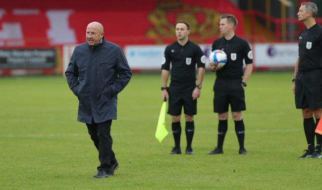 Accrington Stanley boss John Coleman walks off after venting his frustration at the officials after the defeat to Oxford United   Picture: Richard Parkes