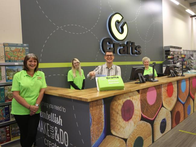 The team at cCrafts in Bicester is led by general manager Richard Dance who cut the cake at the shops opening day on Saturday.