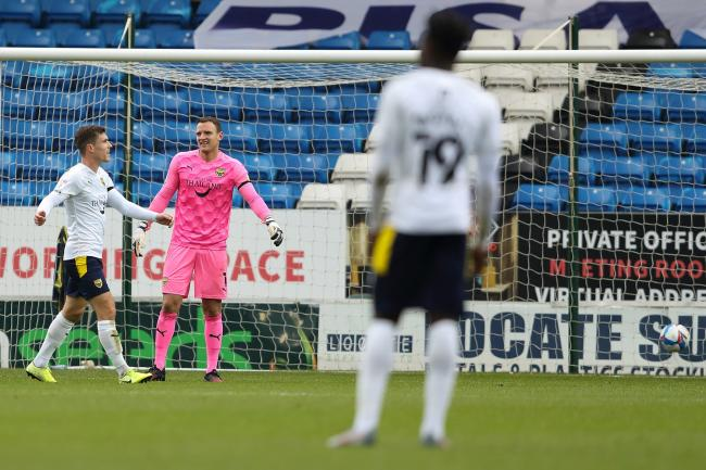 Dejection at the back for Oxford United after conceding the first goal to Peterborough United   Picture: James Williamson