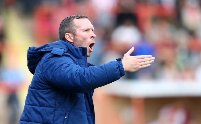 Michael Appleton urges his Oxford United side on in a draw at Exeter City, which left them with three points from the opening seven games of the 2014/15 season   Picture: Gary Day/Pinnacle