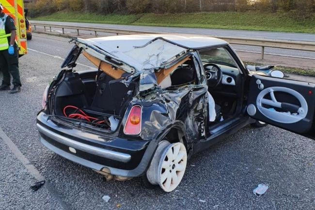 Mini crashes into HGV on M40  after tyre blowout
