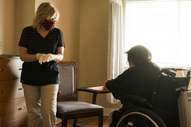 SOCIAL CARE: Care home worker wearing a mask.