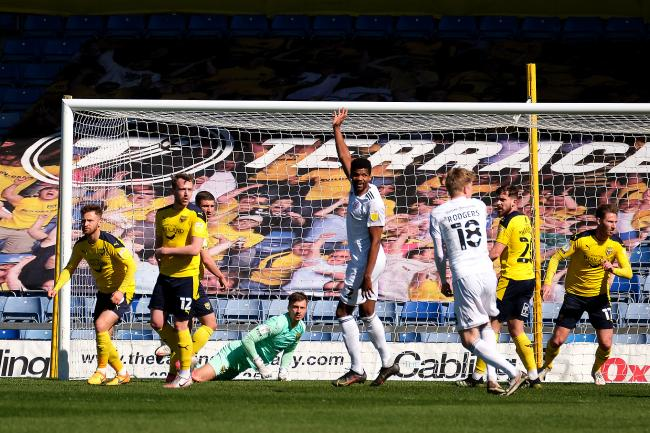 Oxford United's defence nervously awaits the referee's decision after Dion Charles' effort appears to cross the line Picture: Ric Mellis