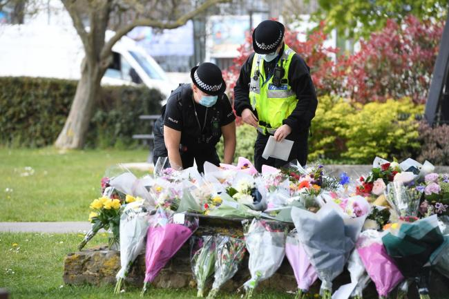 Police officers lay floral tributes to PCSO Julia James