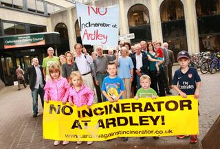 Anti-incinerator campaigners outside County Hall in Oxford before yesterday's council meeting