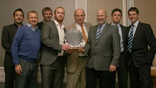 Twyford chairman Stuart Misseldine (third from right) receives the Peter Baker Memorial Trophy from guest of honour Pat Murphy (centre) for the combined performances of their first and second teams