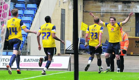 Adam Chapman celebrates his goal from  a corner against Torquay