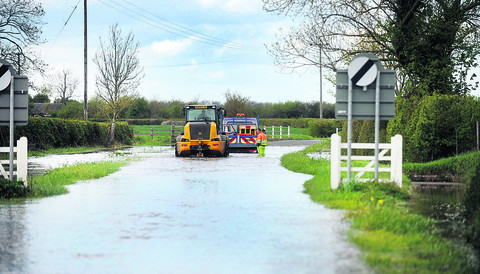 A county council truck has to be helped out after becoming stranded in Denchworth Road, West Hanney, yesterday
