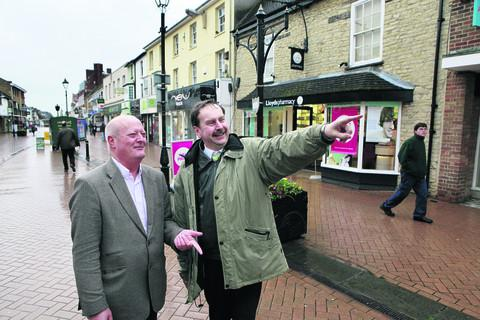 Cllr Norman Bolster, left, and Ben Jackson in Sheep Street, Bicester. The town is bucking the economic trend and is booming