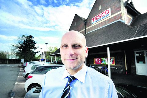 Tesco store manager Chris Webb at the Bicester supermarket's current site. Picture: OX51854 Richard Cave