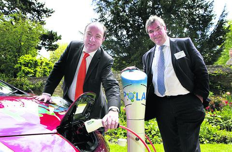 In charge: Transport Minister Norman Baker and David Martell of Chargemaster at this week's launch
