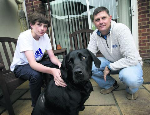Jason Martin, pictured with his son, Jake, and Porter, the dog