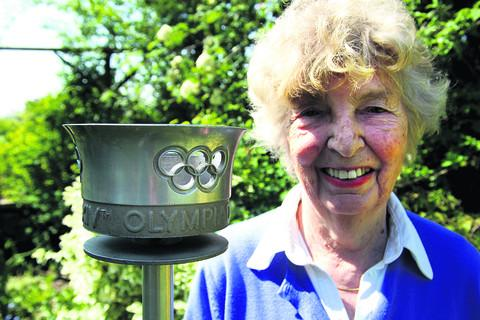 June Barker with the Olympic Torch her husband Peter carried through Ascot in the run-up to the 1948 Olympics