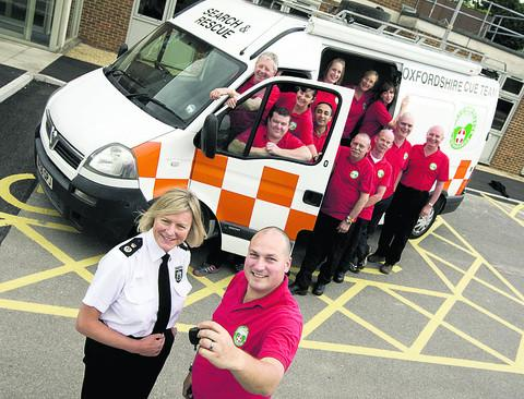 Chief Constable Sara Thornton and Steve Butcher, front, with Oxsar members and their control van