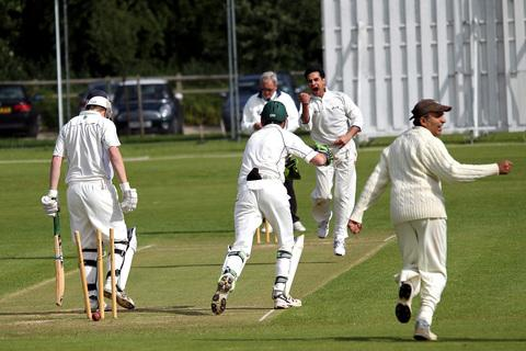 Oxford & Bletchingdon Nondescripts' Ayaz Khan celebrates bowling Mark Wingfield Digby, the first of his ten victims