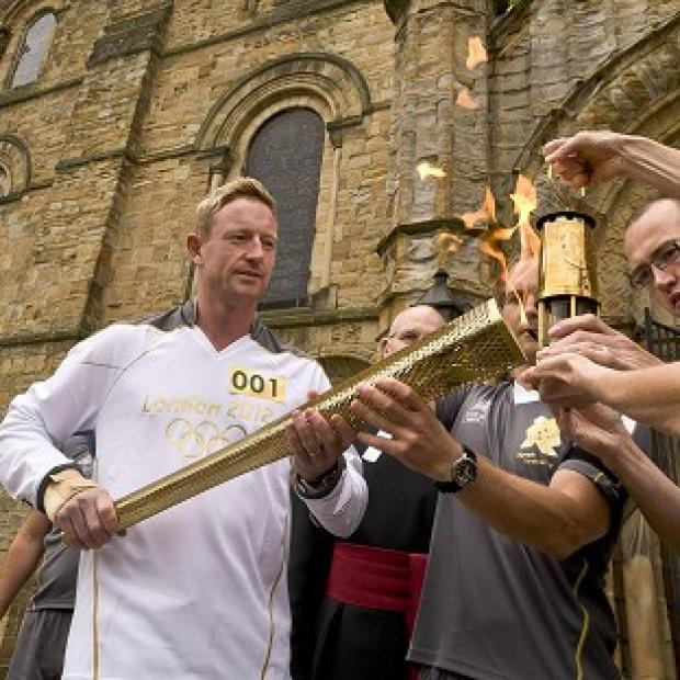 Bicester Advertiser: Ashes-winning cricketer Paul Collingwood brandished the Olympic Torch like a cricket bat as he started Day 30 of its tour around Britain and Ireland
