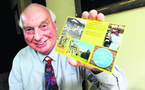 David Buxton, who has created two postcards which will be sold as Olympic memorabilia at a sale at the British Library. He is pictured with the Oxford postcard for the centenary of Arnold Jackson's Stockholm Olympic gold medal victory