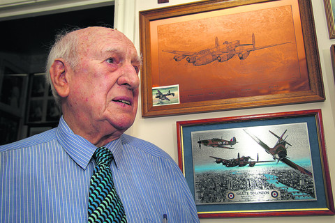 Douglas Tew, with memorabilia of his service as a Lancaster navigator in the Second World War