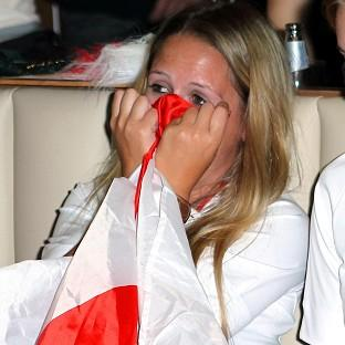 The agony of a penalty shoot-out is clear to see on an England fan's face