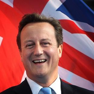 David Cameron expects the London 2012 Olympics and Paralympics to bring an extra 13 billion pounds to the UK's economy