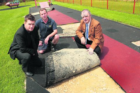 Chris Johnson, Nick Strange and James Porter with the damaged flooring at the play area in George Street Park, Bicester. Pictures: OX52824 Antony Moore