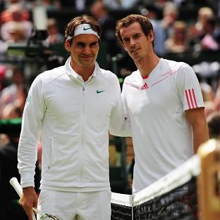 Roger Federer and Andy Murray arrive on Centre Court for the men's singles final