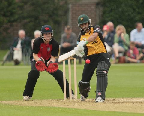 Imran Nazir smashes this delivery through the leg side with wicket-keeper Gus Kennedy looking on as a John Crawley XI took on a Lashings World XI at Christ Church College Sports Ground, Oxford, yesterday