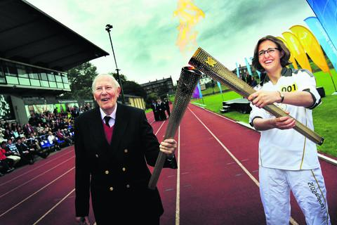Sir Roger exchanges the Olympic flame with Nicola Byrom Picture OX52912 : Ed Nix