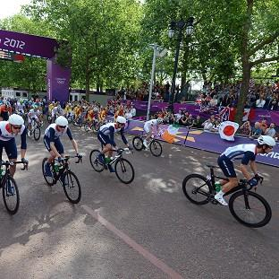 Great Britain with Mark Cavendish (right) start the Men's Road Race on the Mall, London