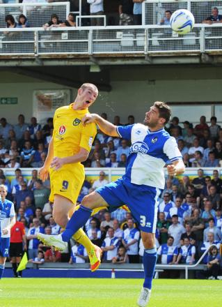 The sweat flies as James Constable gets up with Jim Paterson during Saturday's 2-0 win at Bristol Rovers. 'Beano' will be aiming to open his account against Southend tonight