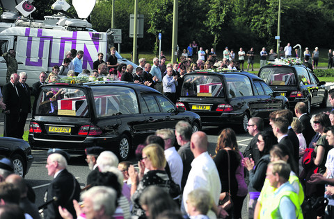 Crowds line roads to salute three fallen heroes